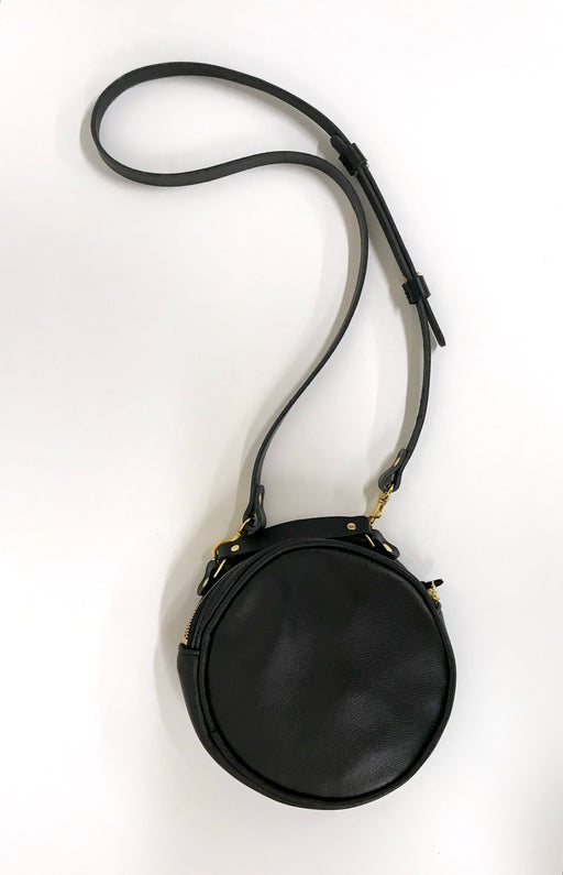 Round leather cross-body bag