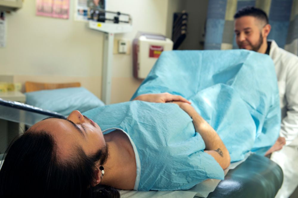 genderqueer person receiving pelvic exam