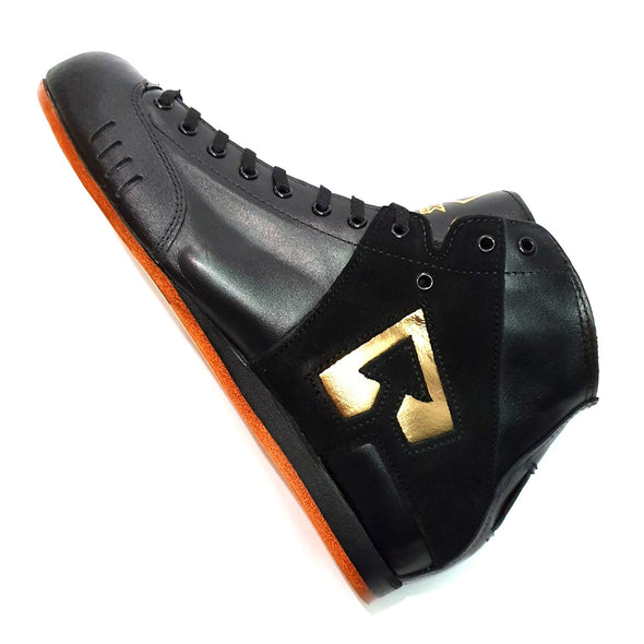 gold and black roller skate boot