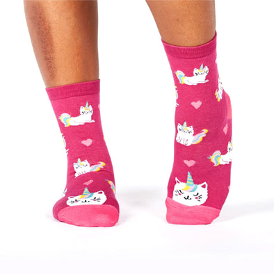 pink socks with unicorns and cats