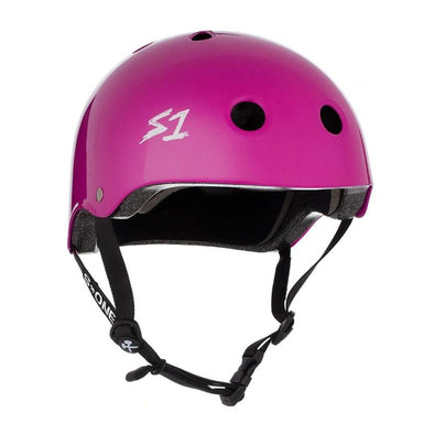 purple bike and skate helmet