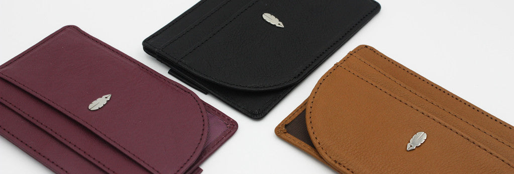 Three slim wallets in different colors