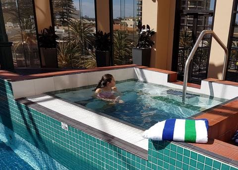 girl in a jacuzzi overlooking Adelaide