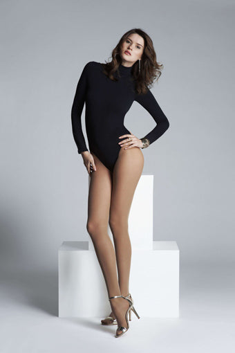 Woman in sheer tan pantyhose, high heels and black leotard,