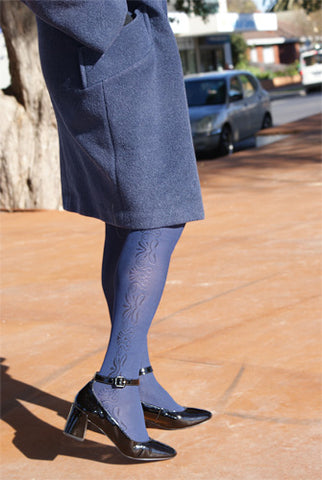 Close up of woman's legs, standing on the street wearing Franzoni Damascata reversible tights.