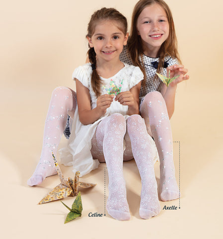 Two young girls sitting side by side wearing sheer white flower print tights.