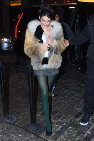 Kendall Jenna out on the town wearing a plaid top with an oversized jacket and green block colour tights.