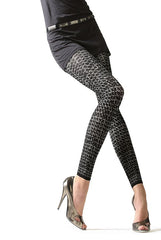 Lady's legs in black pattern footless tights and gold shoes.