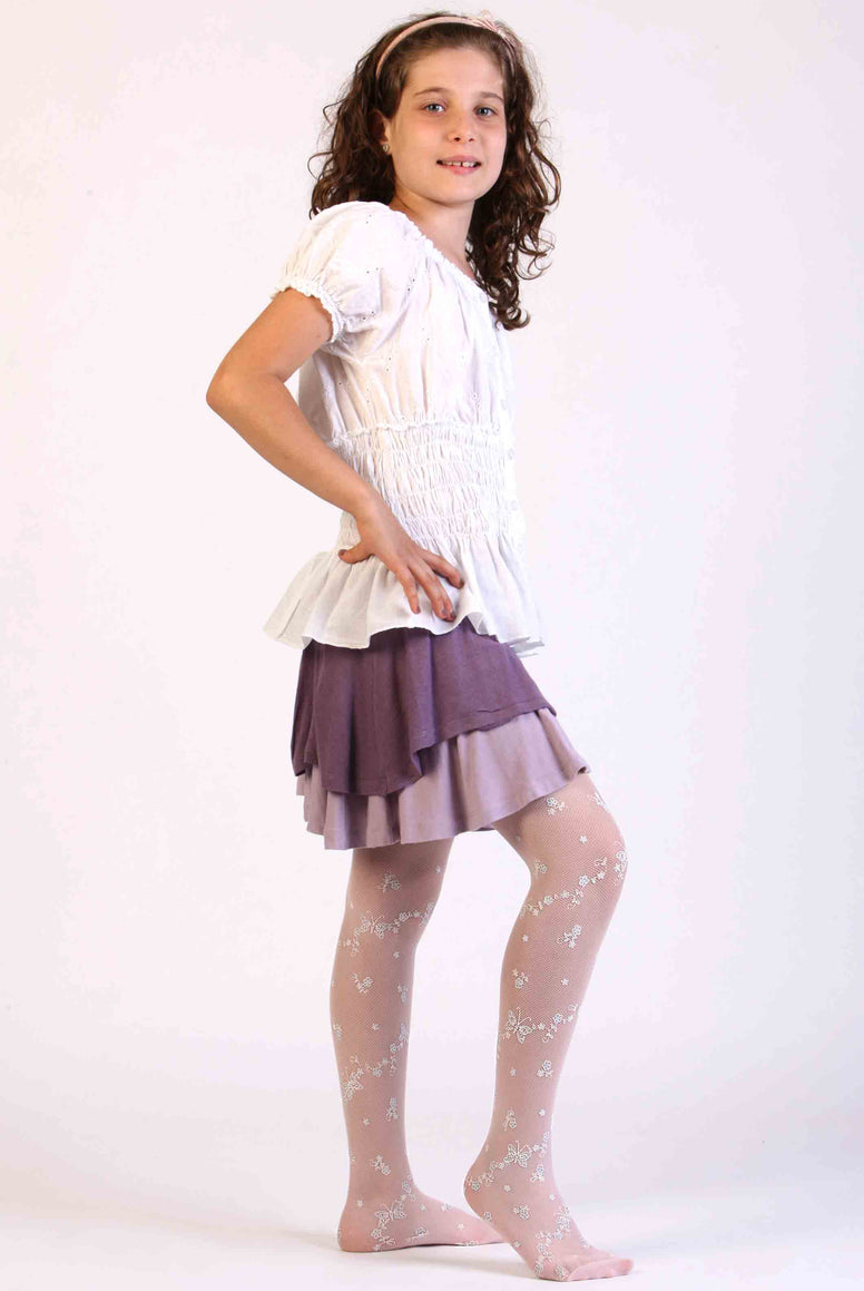 Child displaying her white tulle mesh tights on her legs.