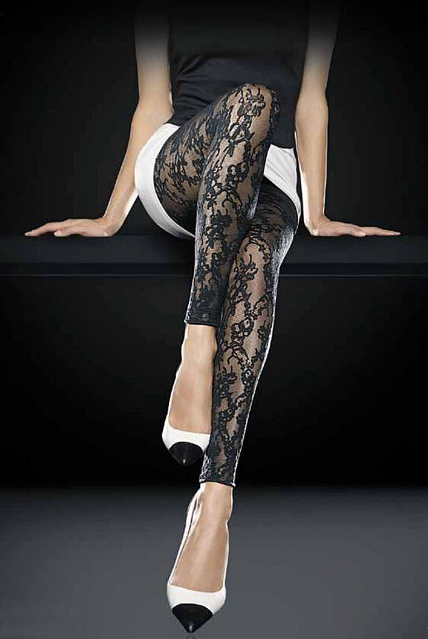 Lady's legs sitting with one knee perched upwards wearing Oroblu Sherry lace footless tights.
