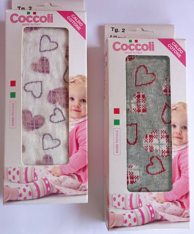 Two boxes of Coccoli heart patterned white and grey tights.