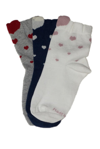 Three pairs of overlapping Coccoli girls' heart pattern socks.