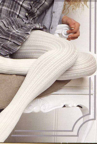 Close up of a girl's legs wearing white cable knit tights.