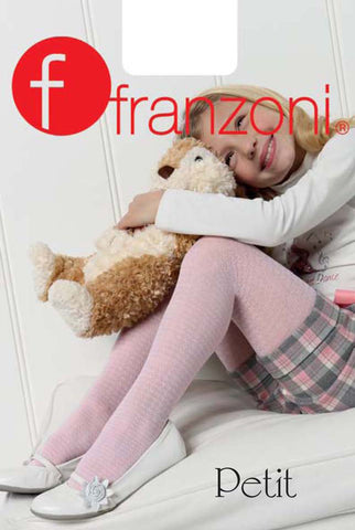 Girl sitting with knees up arm resting on her knees, hugging light brown and cream dog soft toy.