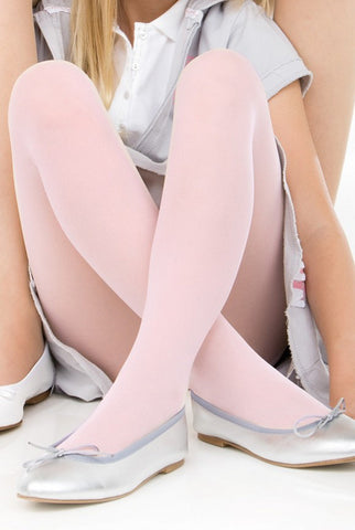 Close up of girls crossed legs wearing pale pink tights and silver ballerina flats.
