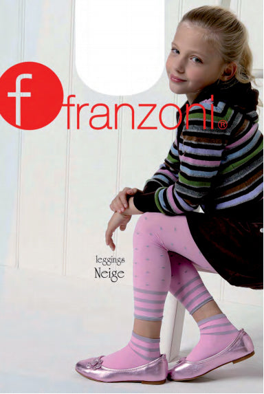 Young girl sitting wearing pink polka dots footless tights and bright striped jumper.