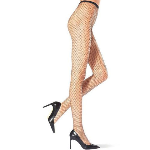 Side view of lady's legs, one leg is lifted at the knee wearing black large net fishnet tights.