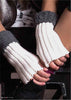 Lady's hands resting on her legs wearing Bugie cream and grey fingerless gloves.