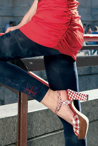 Close up of girls legs wearing Oroblu footless tights, red and white pumps and red top.