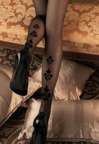 Close up of back of lady's lower legs wearing Oroblu Roseanne Sheer pattern stockings and black stilettos.