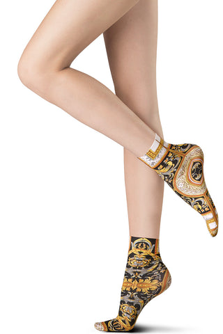 Lady's feet wearing baroque print ankle socks by Oroblu.