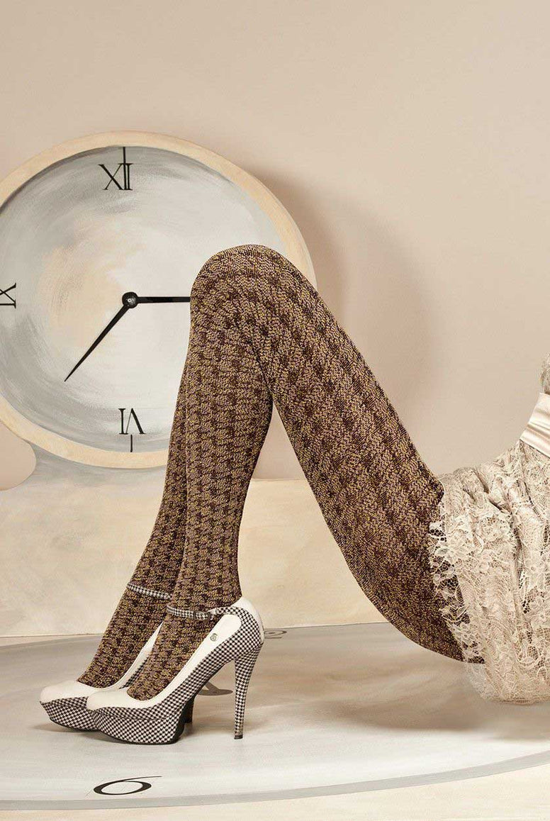 Close up of lady's legs bent at the knee wearing Oroblu Conny lurex tights.