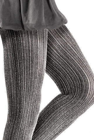 Cloe up black and white photo of lady's legs wearing a short ruffled skirt and ribbed tights