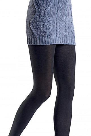 Front side view of lady's legs walking and wearing plain knit Tessie Oroblu black tights in grey high heeled shoes. Some of her long cable knit grey jumper can also be seen.