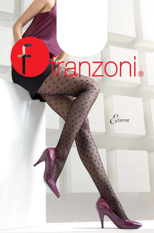 Lady's legs resting against a white wall in black diamond mesh tights and glossy pink heels.