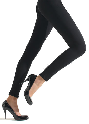 Side view of ladies legs in black leggings and heels.