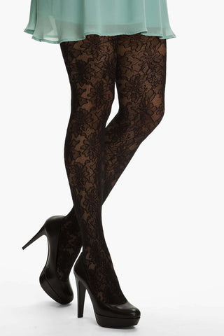 Lady's legs standing and crossed at the ankles wearing Oroblu Marie lace floral tights with black high heels.
