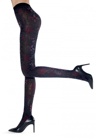 Side view lady's legs, one leg raised, wearing large floral coloured tights.