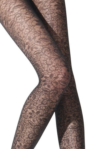 Close up of lady's knees and thighs wearing black floral tights.
