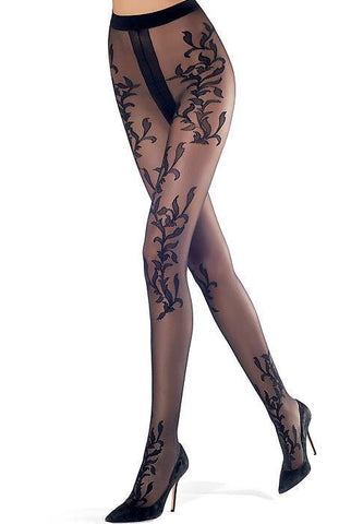 A pair of ladies legs striding, wearing a pair of black vine leaf pattern sheer tights in black high heels.