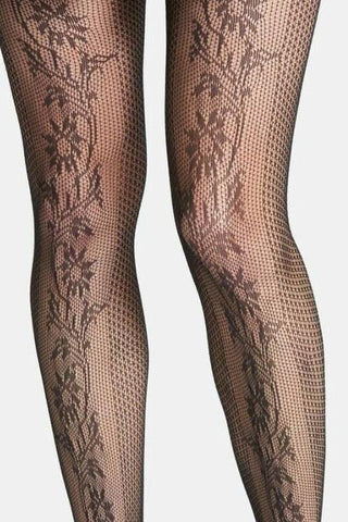 Close up of lady's front legs in black flower fishnet tights.