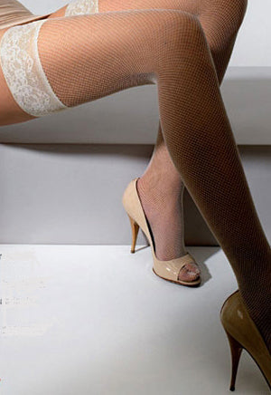 Close up of lady's legs in white fishnet stockings and beige heels.