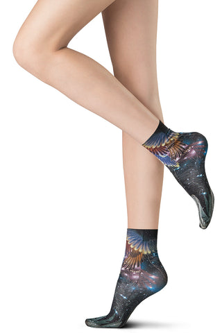 Lady's bare legs wearing space patterned ankle socks on her feet.