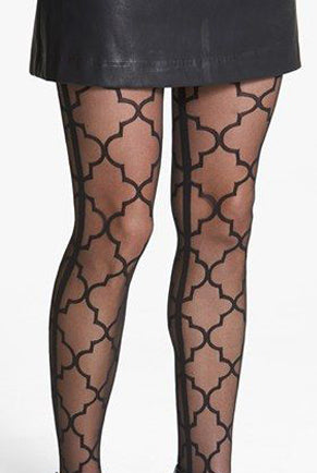 Close up of lady's legs wearing sheer black geometric print tights and short black skirt.