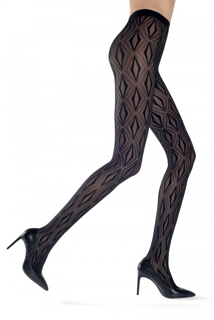 Side view of lady's legs walking, wearing geometric tessellated Oroblu Stacy tights in black high heeled shoes.
