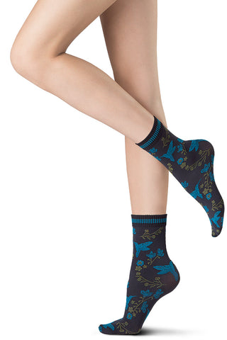 Lady's feet wearing floral patterned ankle socks.