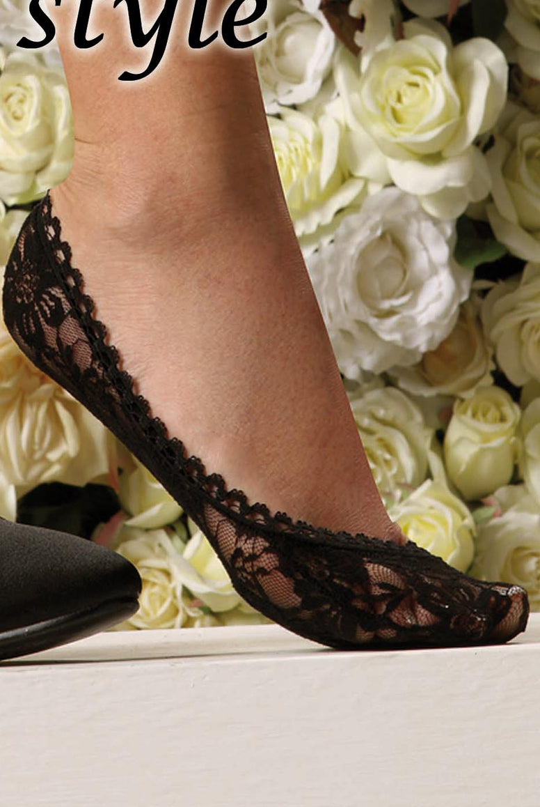 Lady's foot wearing black lace footless.