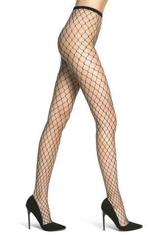 Side view of lady's legs striding and wearing large net fishnet tights with black high heeled shoes.