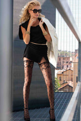 woman wearing black sheer renaissance like pattern tights that resemble stay ups