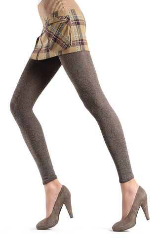 Lady's legs in taupe footless tights and brown heels.
