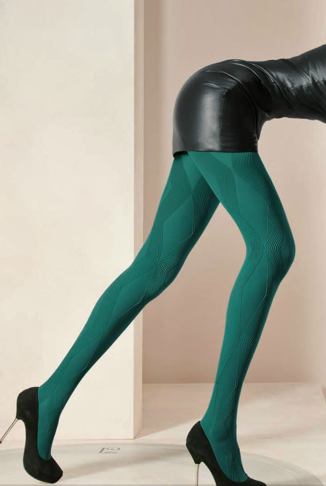651751360ecd5 Side view of Lady's legs slightly apart wearing bold green Dafne patterned  tights.