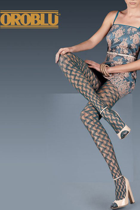 View of Oroblu package portraying a lady wearing fishnet tights and lace brocade dress.