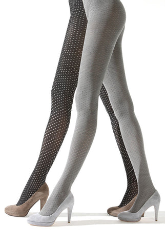 Side view of lady's legs walking and wearing white and black spotty tights Deliziosa tights by Franzoni.