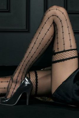 Close up of lady's raised knee in black sheer patterned pantyhose.