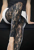 Close up of lady's legs with one knee up wearing Oroblu Sherry black lace footless tights.