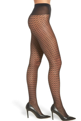 Photo of a side view of ladies legs wearing black geometric patterned tights and black high heeled shoes